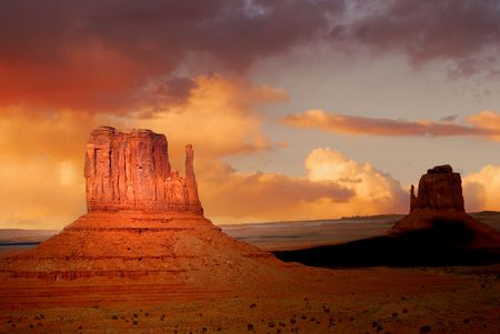 Twin peaks of rock formations in the Navajo Park of Monument Valley Utah Stock Photo - 2887408