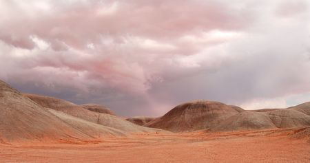 Dramatic sky looming over sand dunes near Monument Valley photo