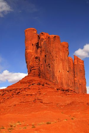 Large rock formation found in the Navajo nation land of Monument Valley photo