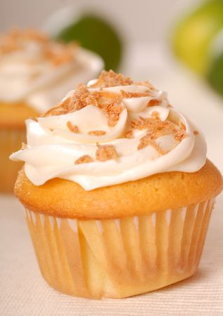 Freshly baked vanilla cupcake with lemon buttercream and toasted coconut Stock Photo