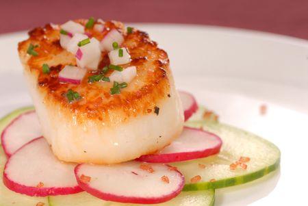 seared: Fresh seared sea scallop on radish and cucumber with red sea salt Stock Photo