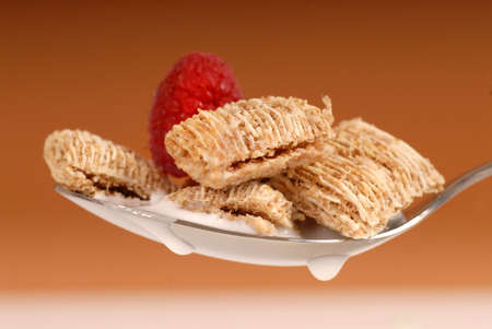 Delicious spoonful of shredded wheat with milk and raspberry Stock Photo - 3452007