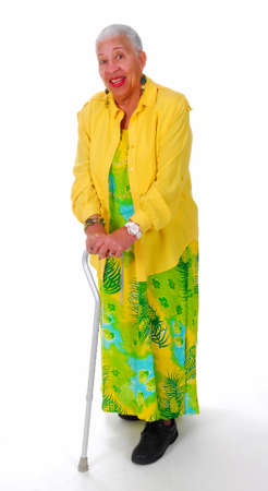 Attractive African American woman standing leaning on a cane Stock Photo