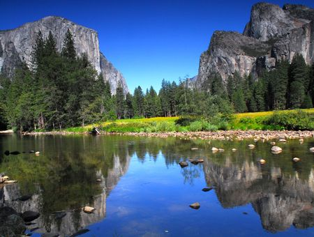 Summertime view of El Capitan in Yosemite National Park from the Merced River Stock Photo - 3534614