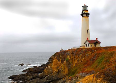 Lighthouse along the California coast on a gray stormy day photo