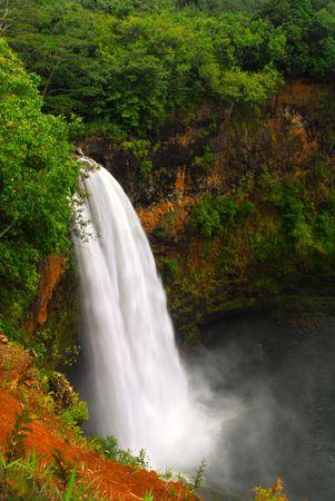 kauai: Dramatic view of Wailua Falls in Kauai Hawaii taken with slow shutterspeed