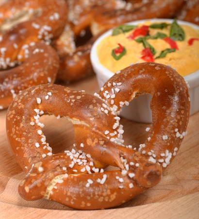 pretzel: Delicious and rustic fresh German style pretzel served with a cheddar cheese spread