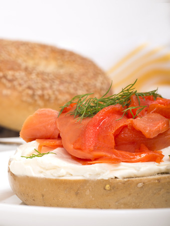 jewish cuisine: Delicious freshly baked Everything Bagel with cream cheese, lox  also known as salmon  and dill