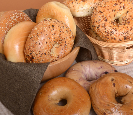 A variety of freshly baked bagels including plain, cinnamon raisin, blueberry, and Everything photo
