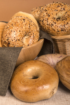 Assortment of freshly baked bagels including plain, everything, onion, sesame seed, cinnamon, blueberry and raisin  photo