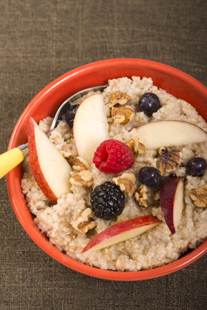 whole pecans: Bowl of delicious steel cut oats with fresh fruit, honey