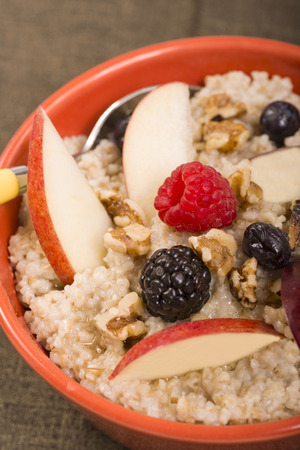 whole pecans: Bowl of delicious steel cut oats with fresh fruit, nuts honey