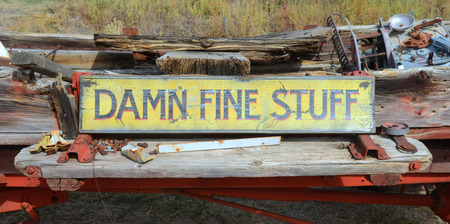 old furniture: Damn Fine Stuff sign found in a yard that was selling antiques and memorabilia Stock Photo