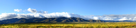 roadway: Panoramic view of the mountains and plains of northern New Mexico taken in the autumn Stock Photo