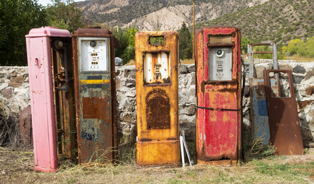 Collection of old rusting gas pumps found in an antique store in New Mexico photo