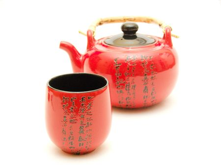 chinese teapot: Red Chinese teapot with cup  Stock Photo