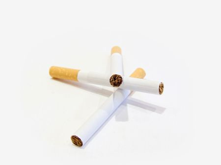 Three cigarettes with the filter on a white background photo