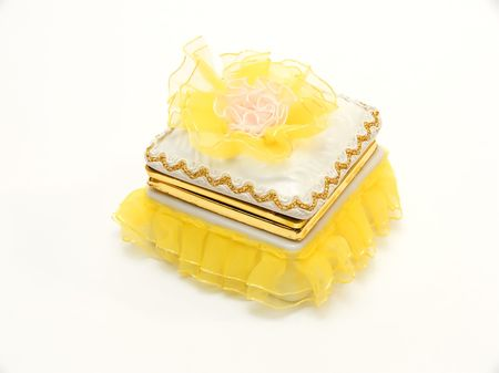 Yellow casket for storage of ornaments and jewelry photo