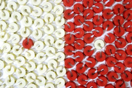 a lot of red and white size washers photo