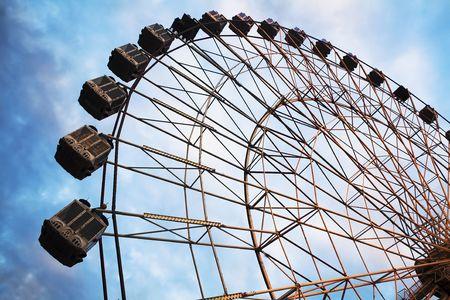 A ferris wheel at an amusement park photo