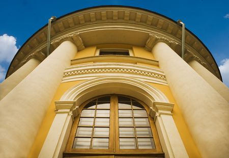 column of a yellow classical building. photo
