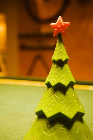 snooker cues: christmas tree with a red star on top on a billiard table