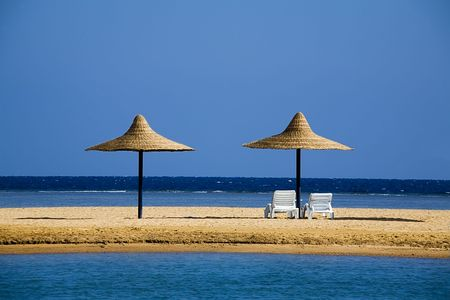 parasols on a beach in the morning (while nobody has come) Stock Photo - 650161