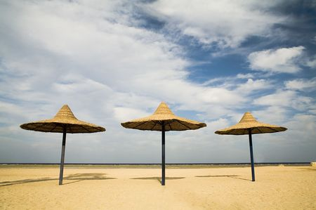 parasols on a coast in the morning (while nobody has come) Stock Photo - 650158