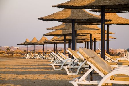 sunbeds and parasols on the beach in the morning Stock Photo - 650152