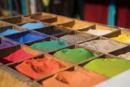tinge: multicolored sand in the boxes. palette Stock Photo