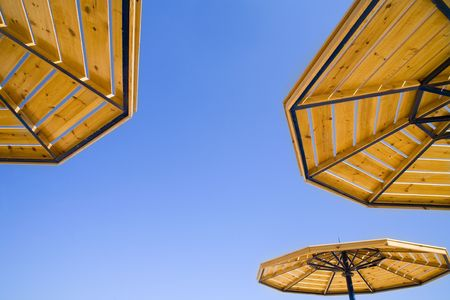 parasols on a blue summer sky. A traditional picture of rest. Stock Photo - 659589