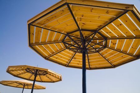 parasols on a blue summer sky. A traditional picture of rest. A view from a sunbed. Stock Photo - 659588