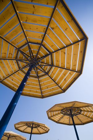 parasols on a blue summer sky. A traditional picture of rest Stock Photo - 659586
