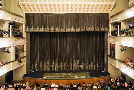 Moscow theatre stage with a dark-green curtains