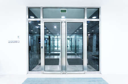 opening door: glass doors in an office Stock Photo