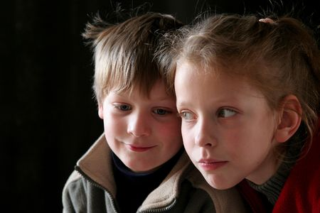 A couple of children against a black background photo