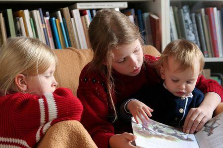 Three children reading together