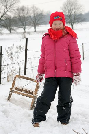 Little girl and her sled photo