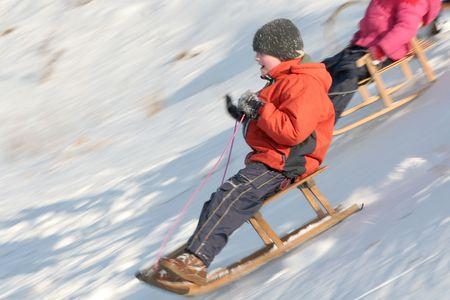 Children sledding photo