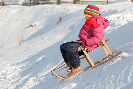Little girl sledding photo
