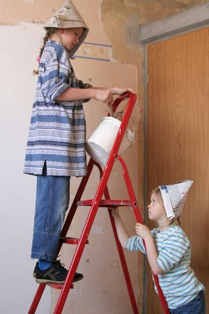 Two girls on a ladder photo