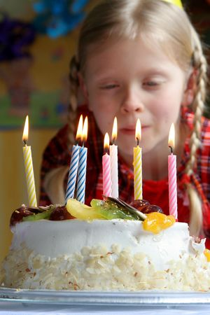 Birthday cake against a background of a little girl photo