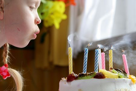 girl blowing: Little girl blowing birthday candles