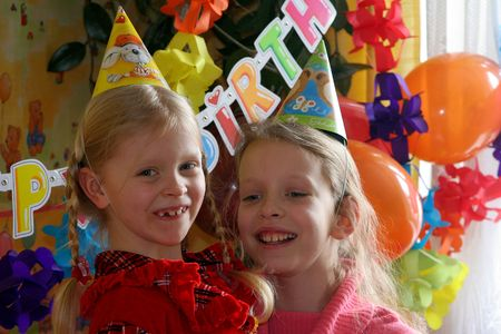Two girls at the birthday party Stock Photo