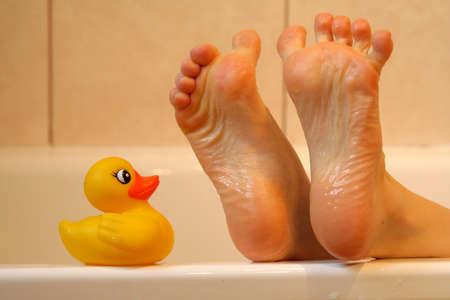 duck feet: Feet meeting bath duck