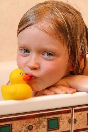 nude little girls: Portrait with bath duck