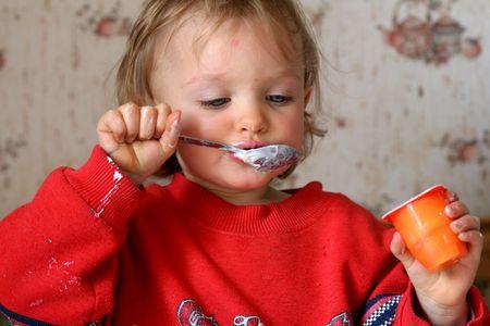 Little  eating yogurt