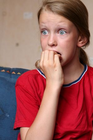 horrifying: Watching TV Stock Photo