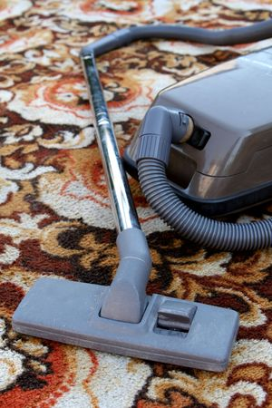 vac: Cleaning carpet Stock Photo