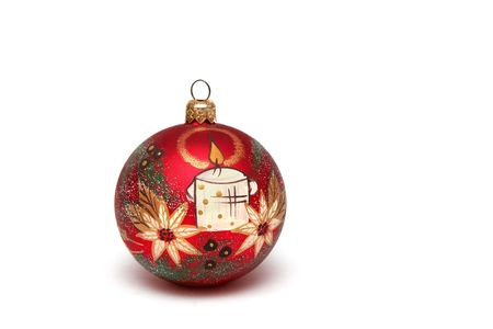 Red christmas bulb decorated with white candle